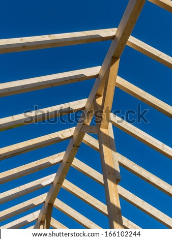 in a house a new roof is built on a construction site. carrier wooden roof.