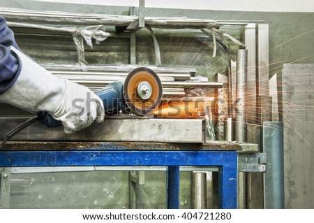 in a metal workshop - grinding - stock photo