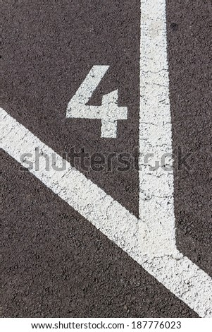 in a parking lot with numbers are the individual parking spaces labeled
