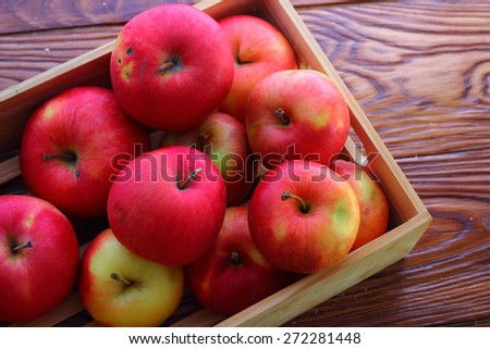 in a wooden box heap of apples - stock photo
