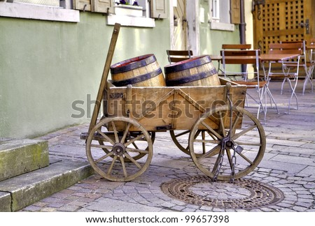 in a wooden vehicular laying two wine barrel for decoration