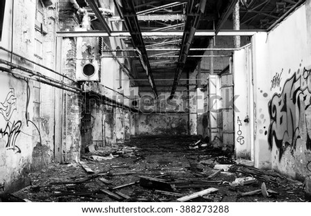in an old teared of broken abandoned factory - stock photo