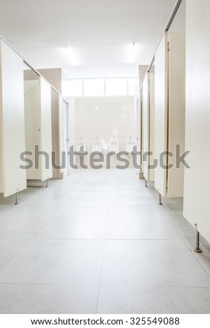 In an public building are mans toilets whit white doors