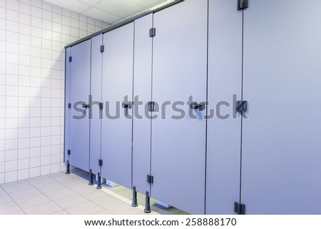 In an public building are womans toilets whit black doors - stock photo