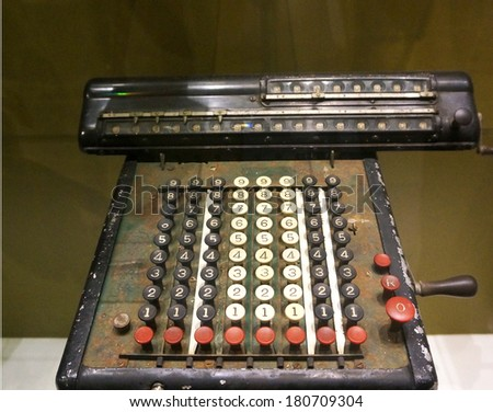 In ancient calculator used for statistical calculator and calculate. It made of the metal, heavy weight.                                - stock photo