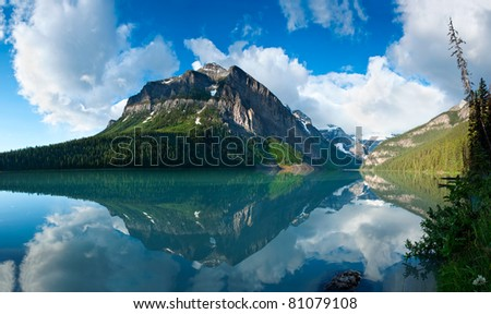 In Banff National Park, Alberta, Canada, a beautiful reflection of the mountain peaks around Lake Louise - stock photo