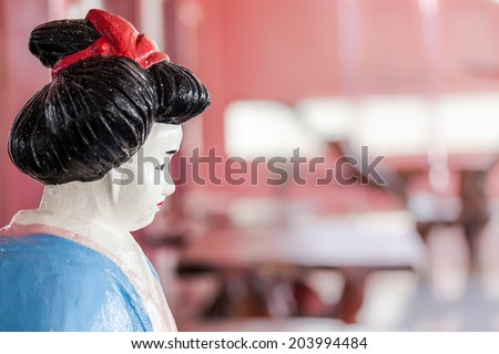 In Bangkok stay an asian statue woman in an shopping mall - stock photo
