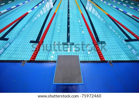In center one platform for  start and lane of swimming pool - stock photo
