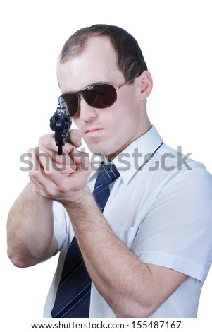 In dark glasses a man with a gun