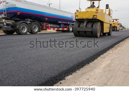 In flexible pavements, the upper layer consists of asphalt concrete, that is a construction aggregate with a bituminous binder. The wearing course is typically placed on the base course - stock photo