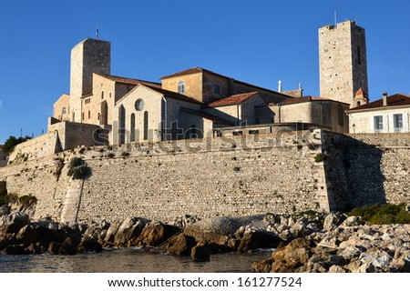 In France, Antibes old town is surrounded with ramparts, The castle Grimaldi shelters a museum dedicated to Pablo Picasso, the famous surrealist painter. - stock photo