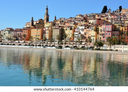 In France, on the french riviera, Menton old town is the heart of the city which falls cascading towards the mediterranean sea with its ocher facades and its baroque basilica Saint Michel. - stock photo