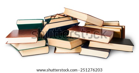 In front piled on a bunch of old books isolated on white background
