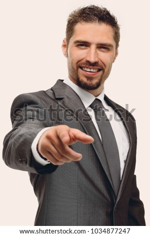 in full growth.closeup.confident businessman pointing forward .