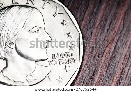 In God we trust. Inscription on the coin of one dollar - stock photo