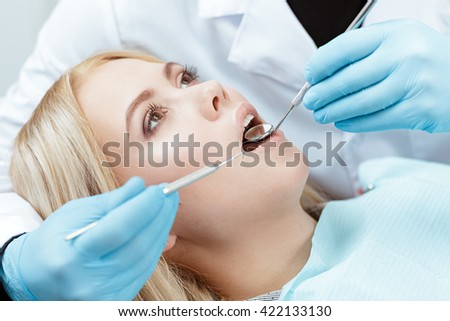 In good hands. Cropped closeup of a young female client at the dental examination - stock photo