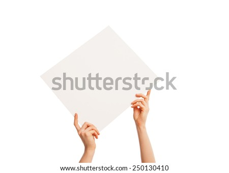 in hand a big blank sheet of white paper held diagonally from left to right. Isolated, over white background. - stock photo
