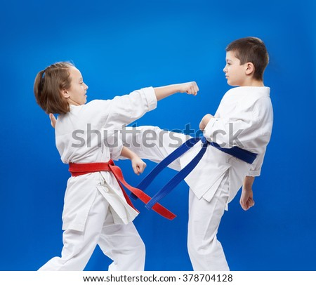 In karategi two athletes train punches and blocks karate - stock photo