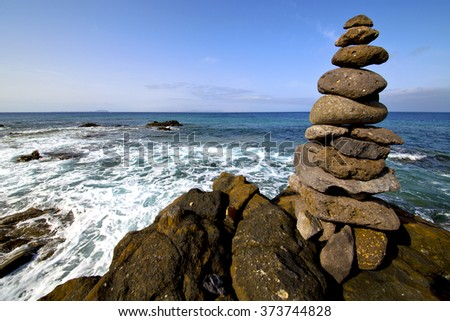 in lanzarote coastline  froth  spain pond  rock stone sky cloud beach  water  musk  and summer     - stock photo