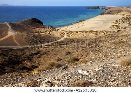 in lanzarote spain pond  rock stone sky cloud beach  water  musk  coastline and summer in lanzarote spain boat yacht - stock photo