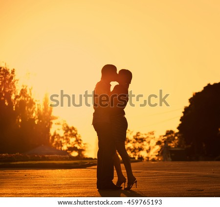 In love concept photo, silhouette of a couple at sunset