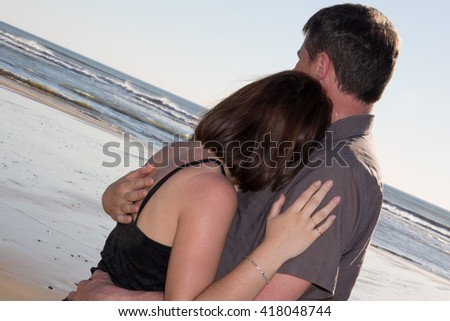 In love couple embracing at the beach  - stock photo