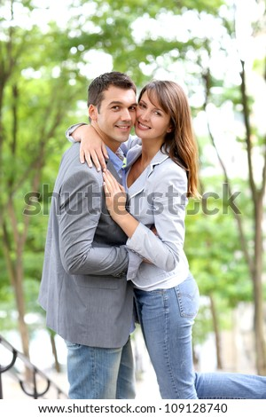 In love couple embracing each other in public stairs - stock photo
