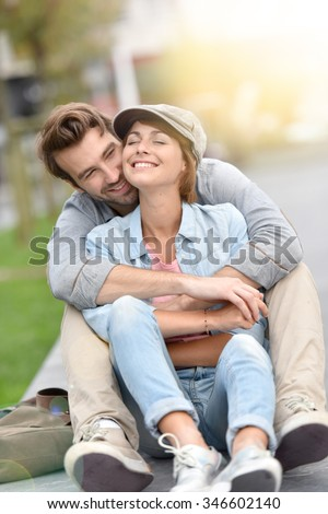 In love couple embracing each other in the street - stock photo