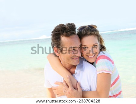 In love couple enjoying vacation at the beach - stock photo