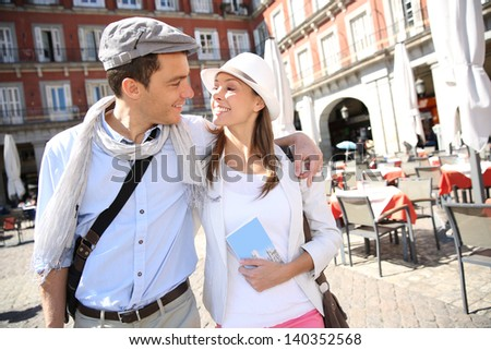 In love couple walking in the street of Eupopean capital - stock photo