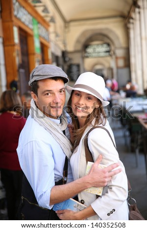 In love couple walking in the street of Madrid, Spain - stock photo