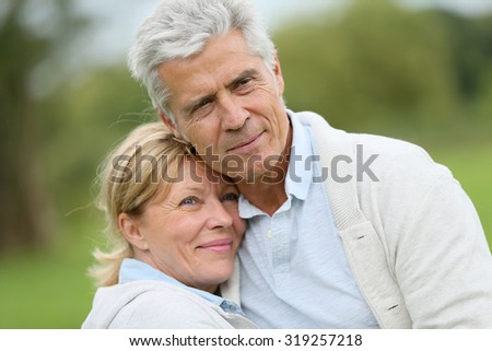 In love senior couple embracing each other  - stock photo