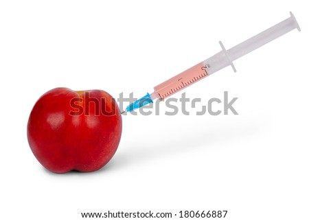 In nectarine stuck a syringe on white. Clipping path included.