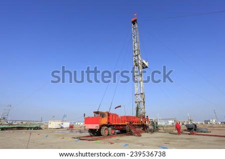 In oil field, oil field derrick work - stock photo