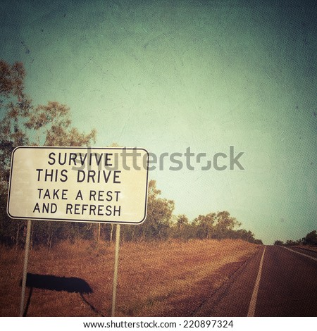 In Order to Survive... Road sign before crossing a desert - stock photo