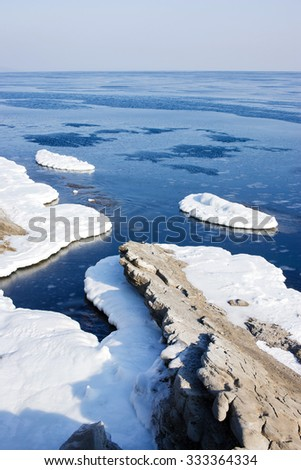 In sea ice, blocks of ice on the sea, the winter sea and the ocean, Arctic, aquatic nature, the ice floe in the ocean, melting ice, spring in the North sea, the Arctic in the spring, wildlife. - stock photo
