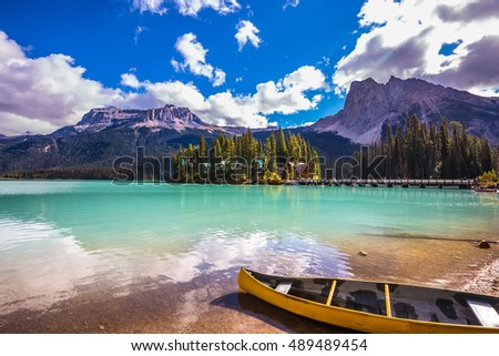 In shallow water the boat is moored. The mountain Emerald lake Yoho National Park. The concept of eco-tourism and active tourism