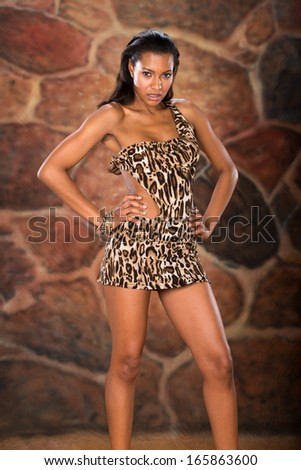 In studio shot of attractive model with stone background - stock photo
