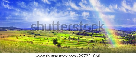In summer, mow grass and pick up their typical style of hundreds Stacks mountains in the background. Ukraine, Carpathian, Starunya- good primer here and a lot of grass and flowers for livestock. - stock photo