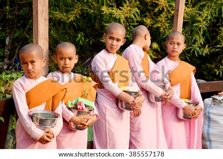 In Thailand at sagktaburi February 22 2016,Nuns wearing pink a Buddhist nun in Burma, People offering - stock photo