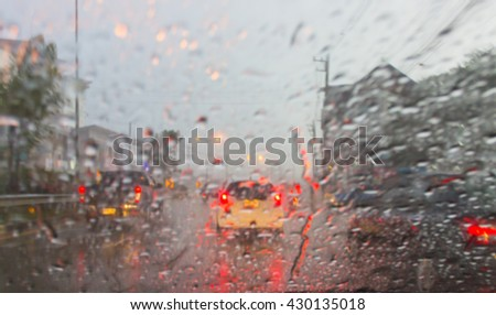 In the car, blur image of heavy rain on the road at night as background. - stock photo