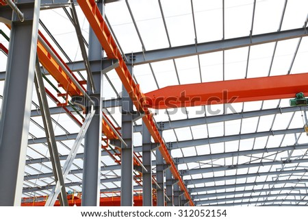 In the construction site, steel structure is under construction - stock photo