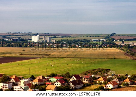 In the countryside landscape with houses and fields in autumn