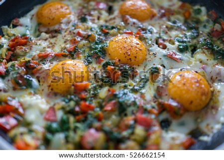 In the course of making breakfast with fresh eggs and vegetables