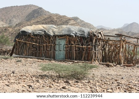 In the desert of Ethiopia, AFrica, nomads make temporary huts from whatever wood they can find.