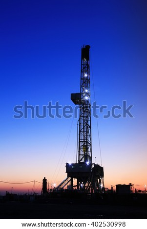 In the evening of oilfield derrick