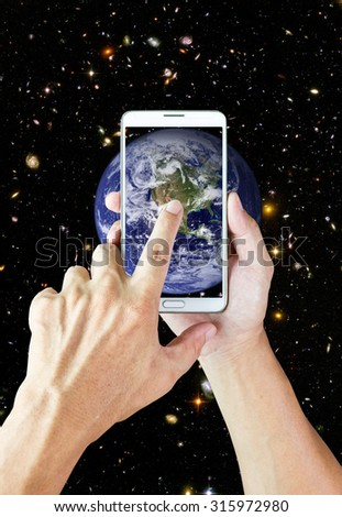 In the future, we can do anything from the smart phone: Elements of this image furnished by NASA - stock photo