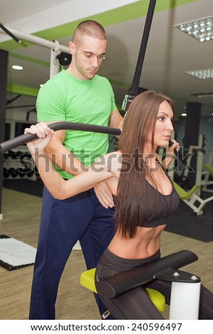 In the gym - couple are exercising in the gym