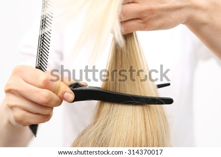 In the hair salon, haircut. Barber haircut  woman with a knife chinese in a hair salon