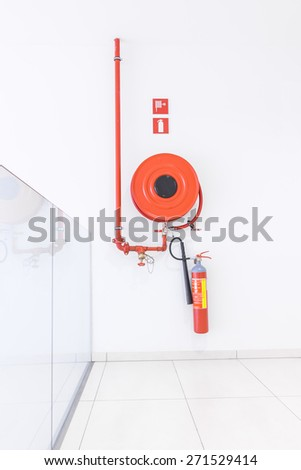 in the hallway of a nice building, there is a fire hose - stock photo